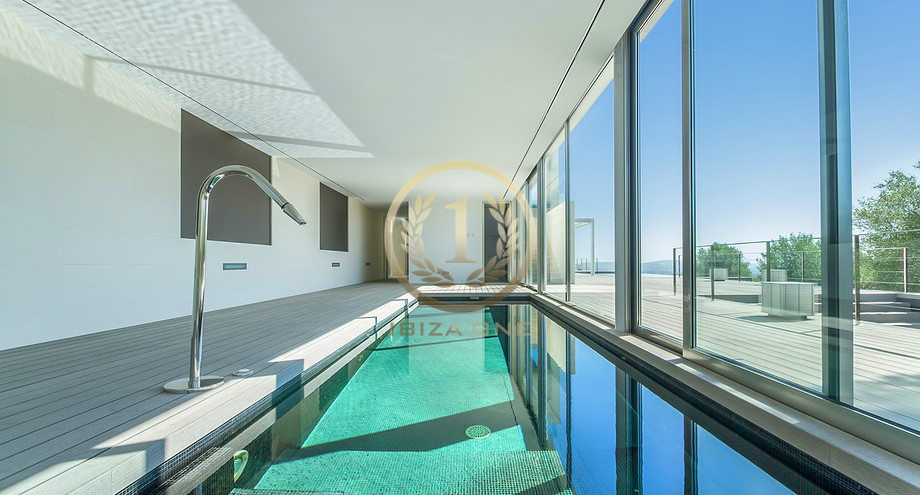 Modern luxury villa with an indoor and outdoor pool for sale ...
